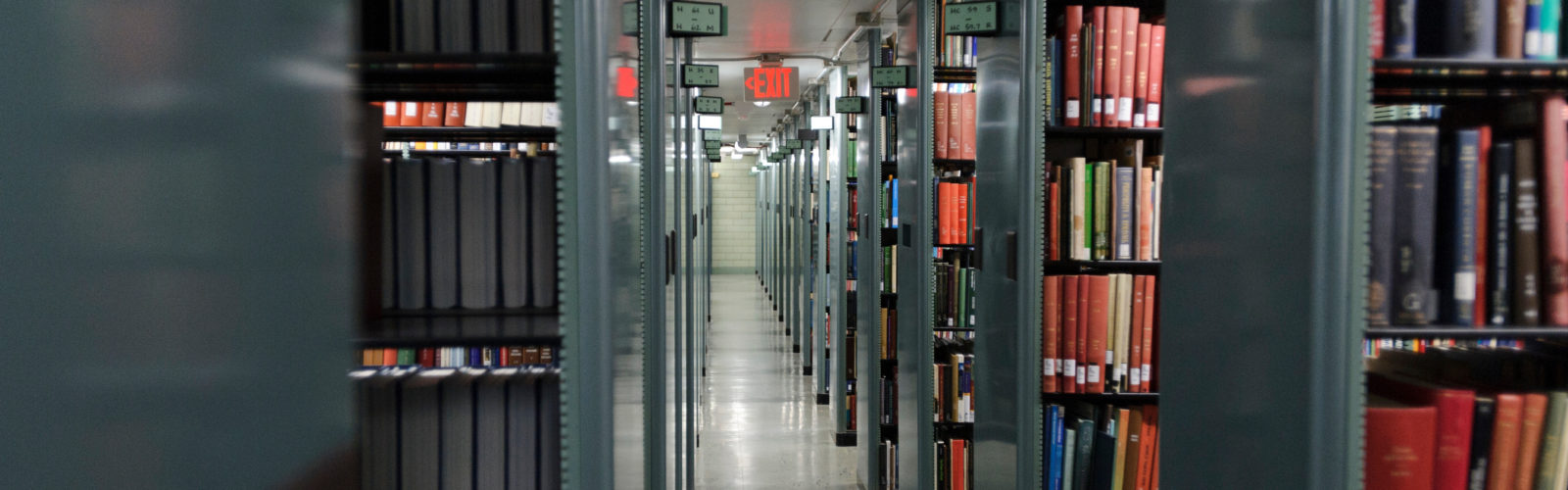 "Overhead lighting shines down upon rows of books shelved in one of the many maze-like ""stacks"" in Memorial Library at the University of Wisconsin-Madison on Sept. 18, 2013. (Photo by Jeff Miller/UW-Madison)"