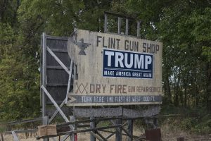 This sign for an area gun dealer in Steuben County, Indiana, is quite old and weathered